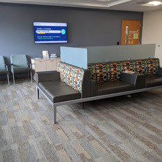 Clinic waiting space with integrated power in furniture.