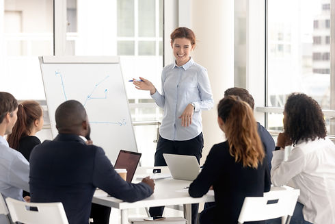 Funny woman leader consulting diverse gr