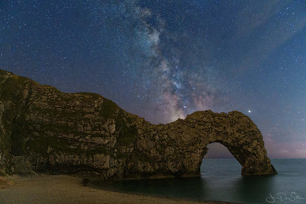 The milky way above the Durdle Door in the UK