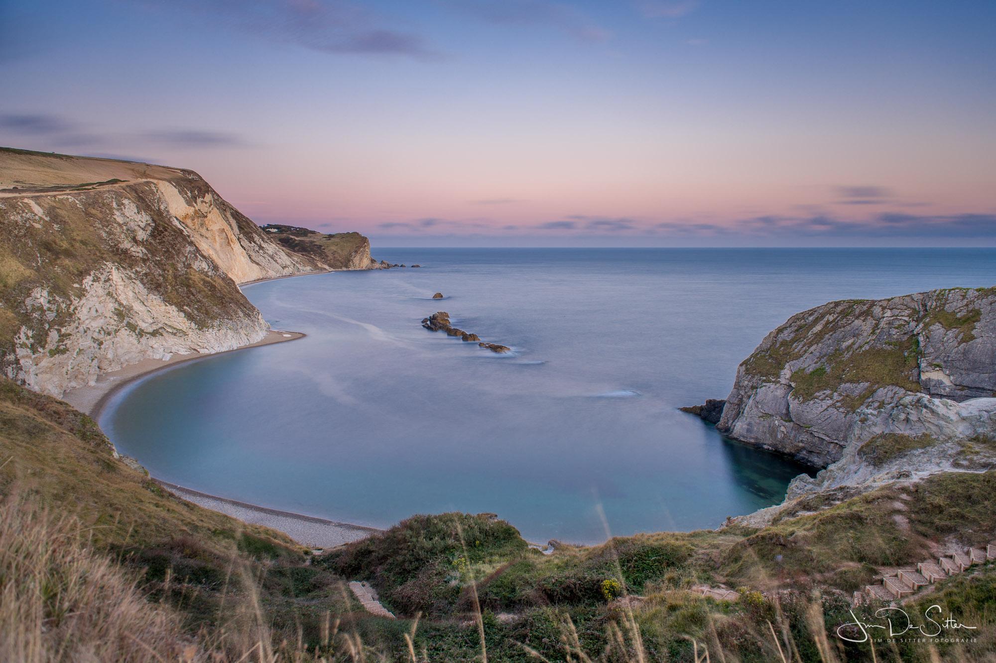 Landschapsfoto : Zondsondergang bij Man'O'War beach in de UK