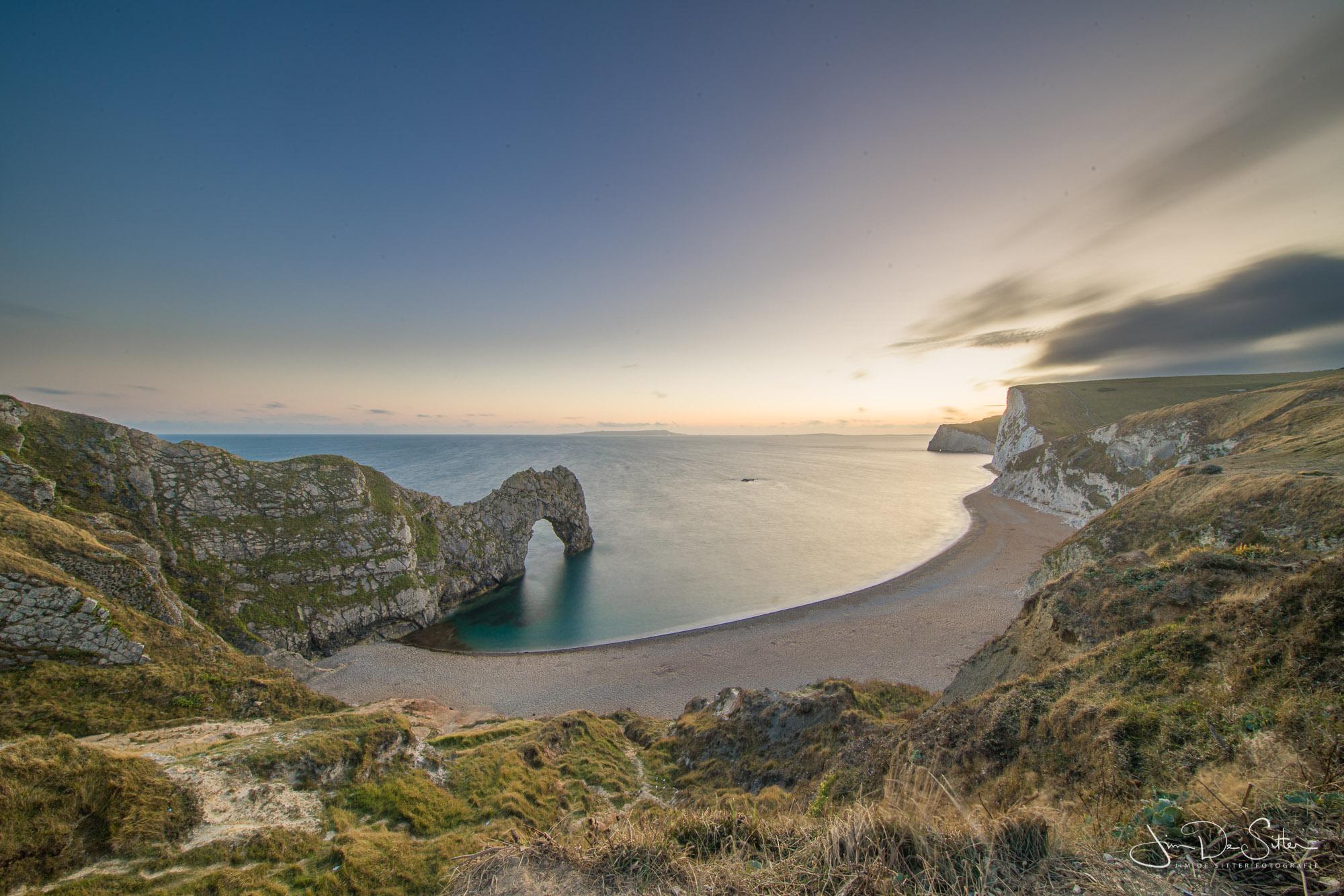 Landschapsfoto : Zonsondergang bij Durdle Door in de UK