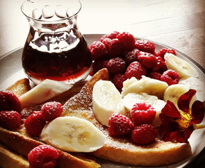 French toast with fruit and maple syrup