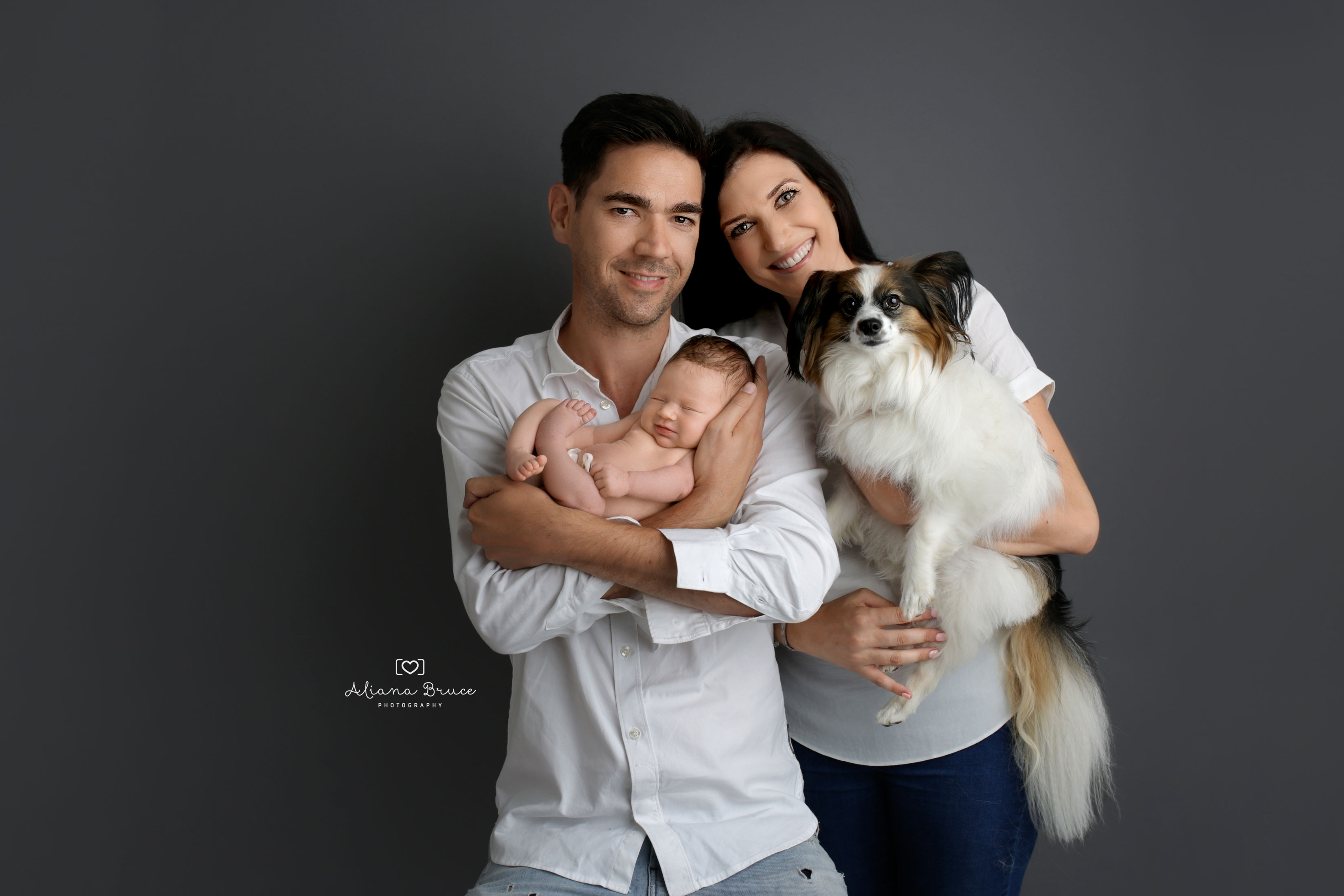 Family with Newborn and Dog
