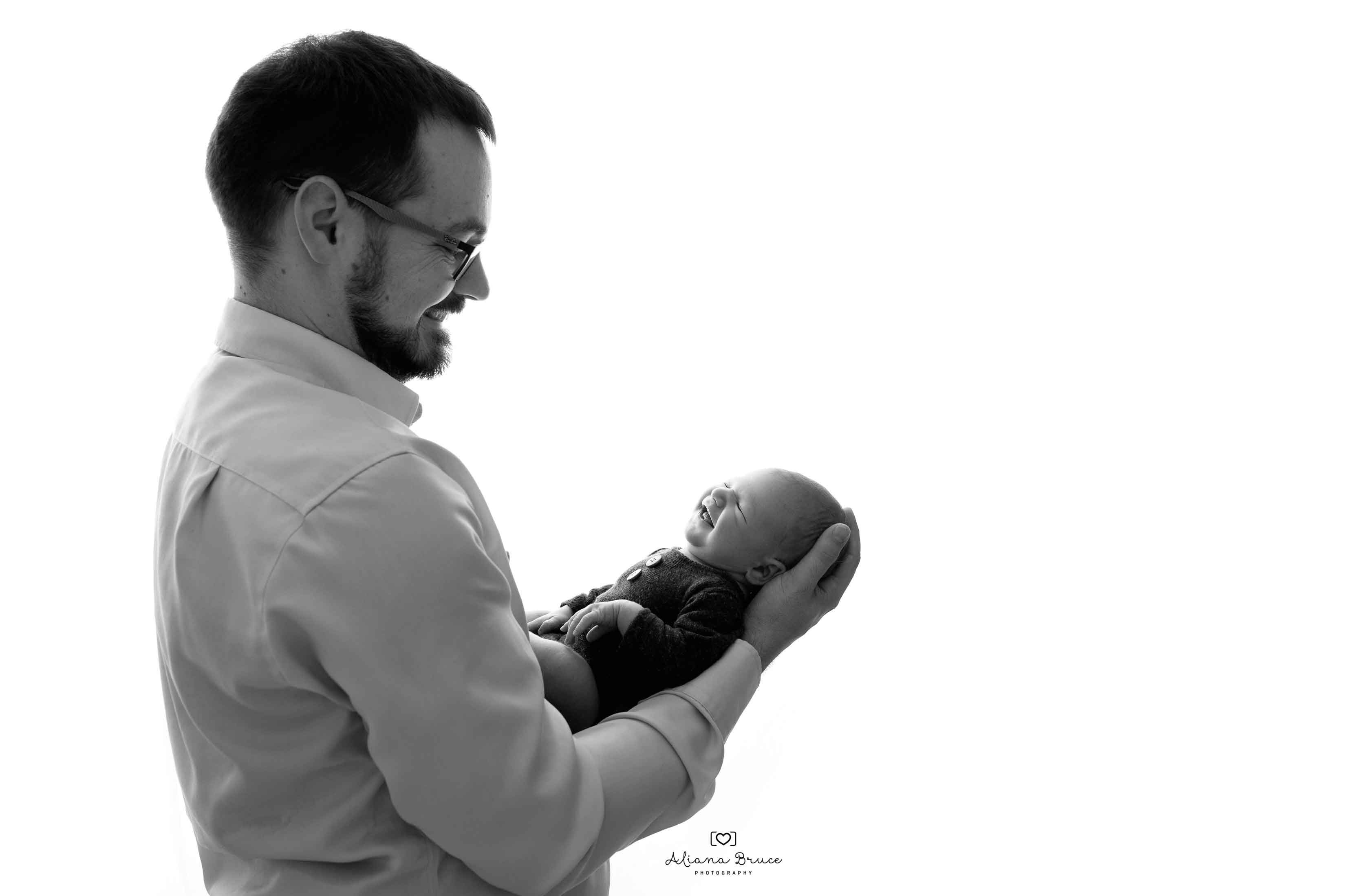 Newborn and dad Photographer Surrey