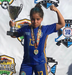 Mia holding the trophy!