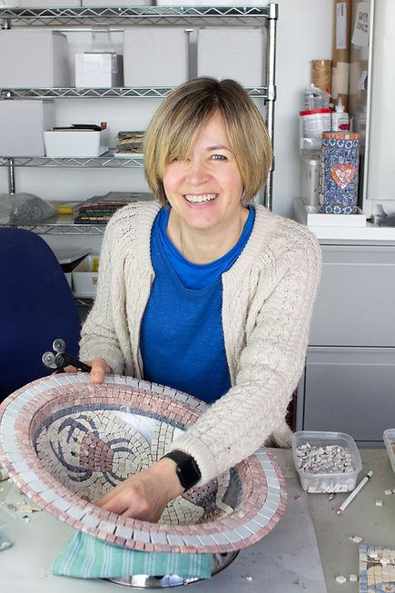 Anne at work smiling.jpg
