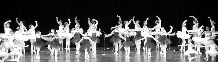 Classic Ballet students in black tutus white tutus