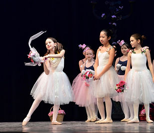 ballet students in performance in tutus