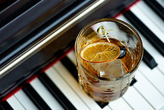 Old fashioned cocktail with orange and c
