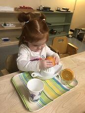 Sophie making orange juice.jpg