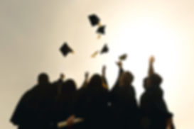 grad-students-throwing-hats-in-the-air.j