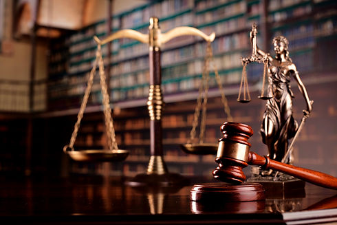 Judge's gavel on library background. Law and justice concept._edited.jpg