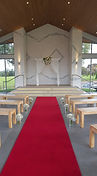 The Vines Chapel with bench seats and ar