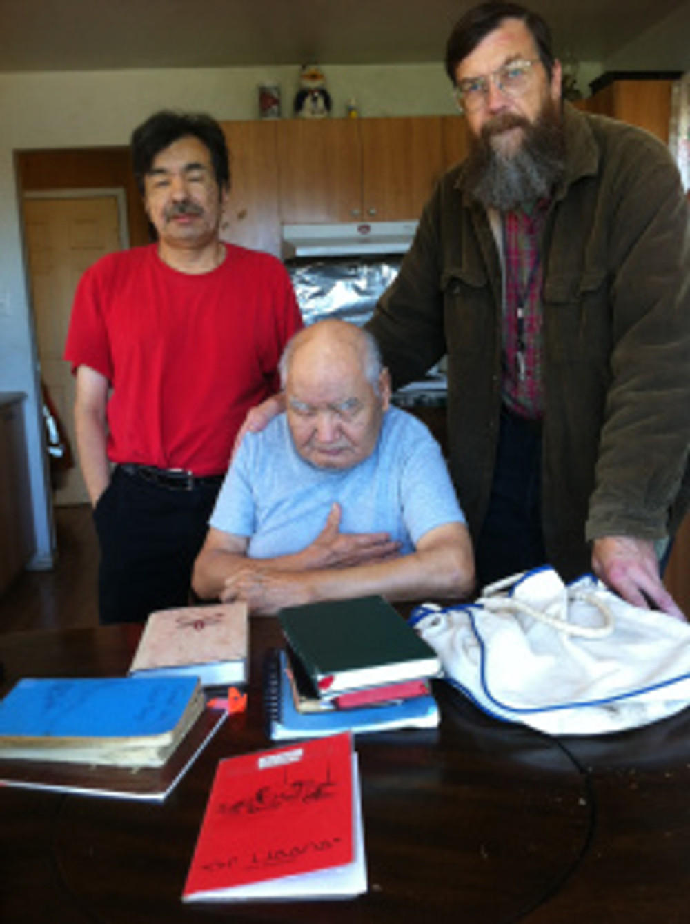 Jude (left) Bill (right) and Phillip with his books