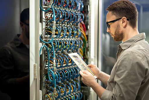 data-center-technician-checking-connecti