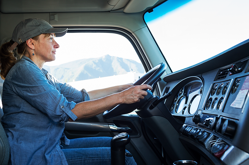 caucasian-woman-truck-driver-in-the-cab-