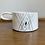 Hand-made white porcelain mug with blue and gold design