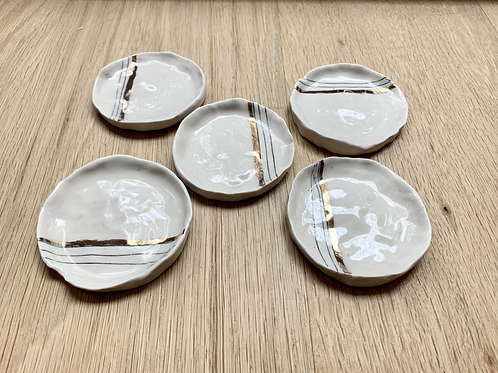 Hand-made white porcelain dishes with blue and gold design front view