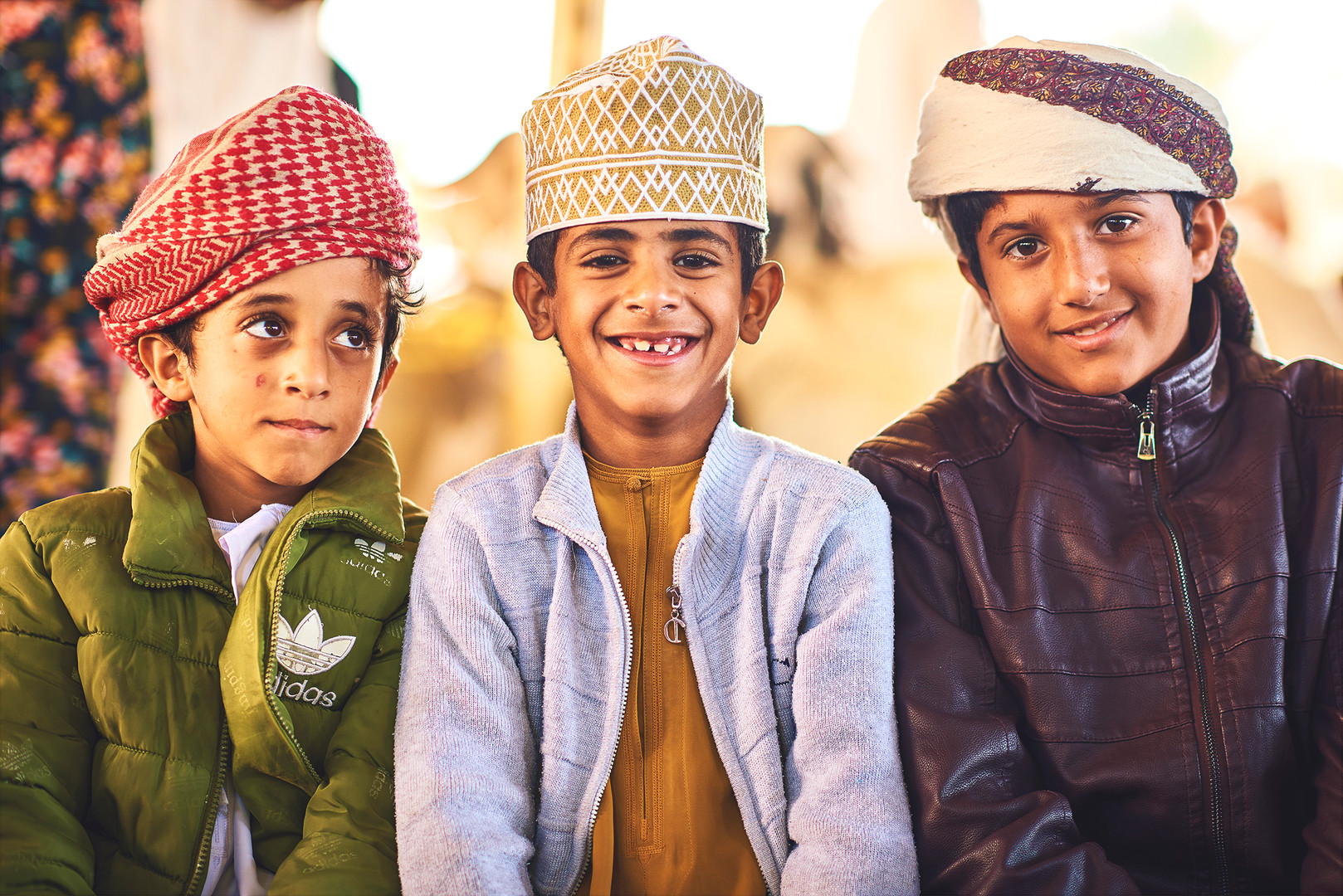 Kids at the live stock market, Oman