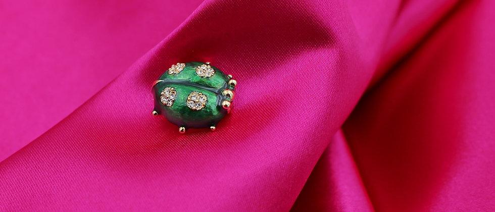Green ladybird brooch
