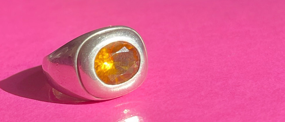 Charming silver ring with an orange stone