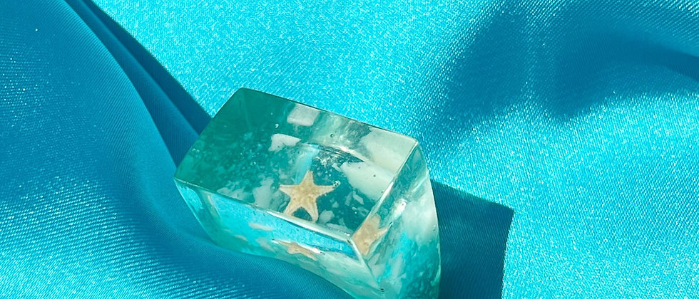 Turquoise ice cube ring with an imprisoned starfish