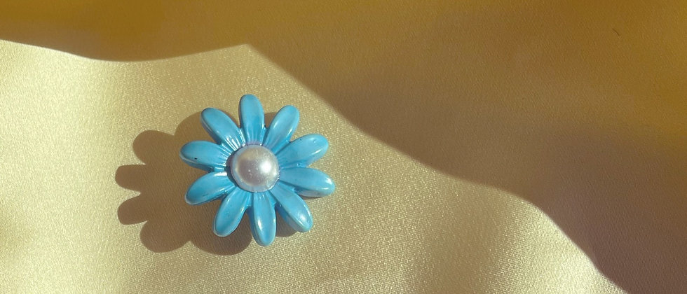 Blue pearly plastic flower clips