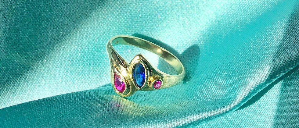 """8kt gold """"toi et moi"""" ring with a sapphire and two rubies"""