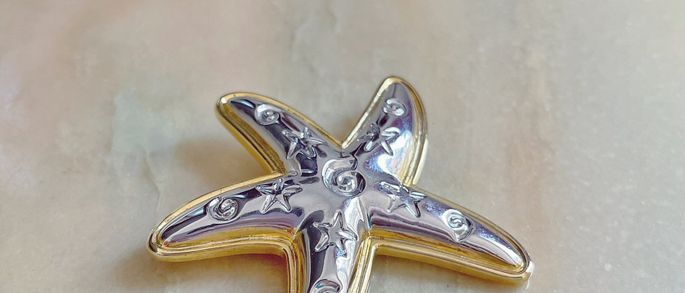 Gold and silver tone star brooch