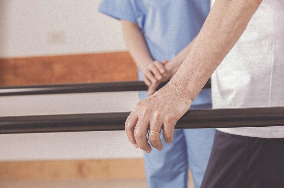 PT with older patient walking.jpg