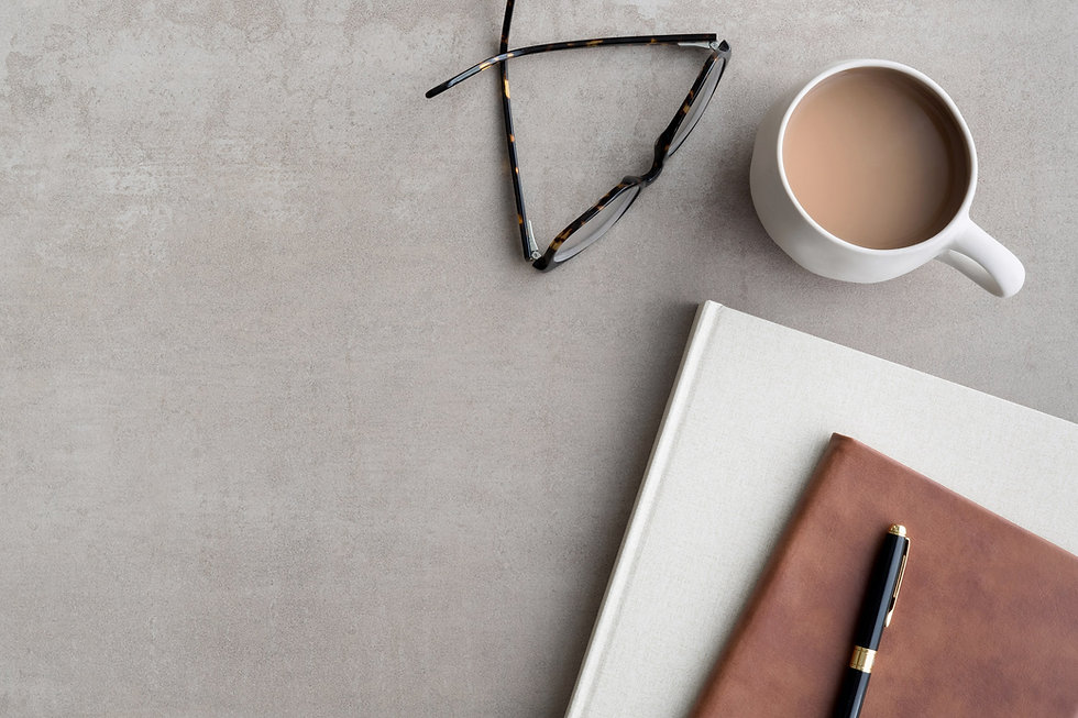 Books coffee and glasses flat lay-min.jpg