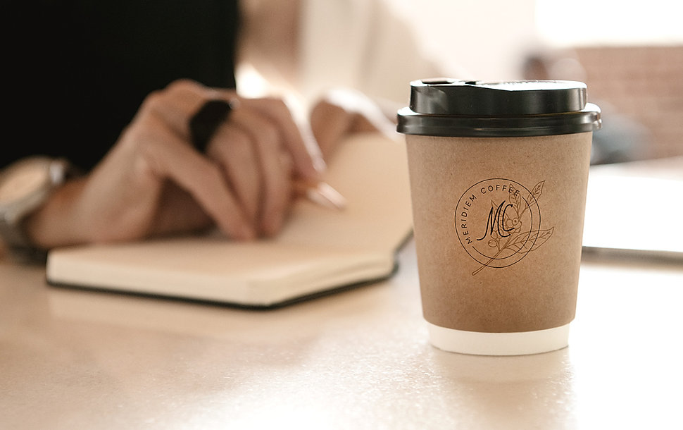 Meridiem Coffee logo on coffee cup mock up