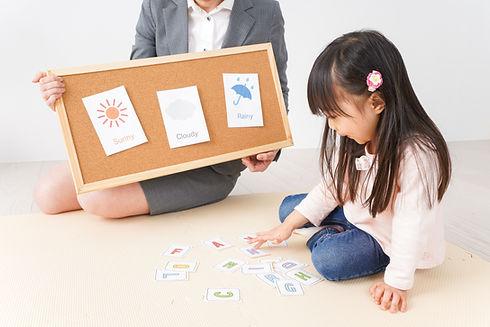 Canva - Children receive the English les