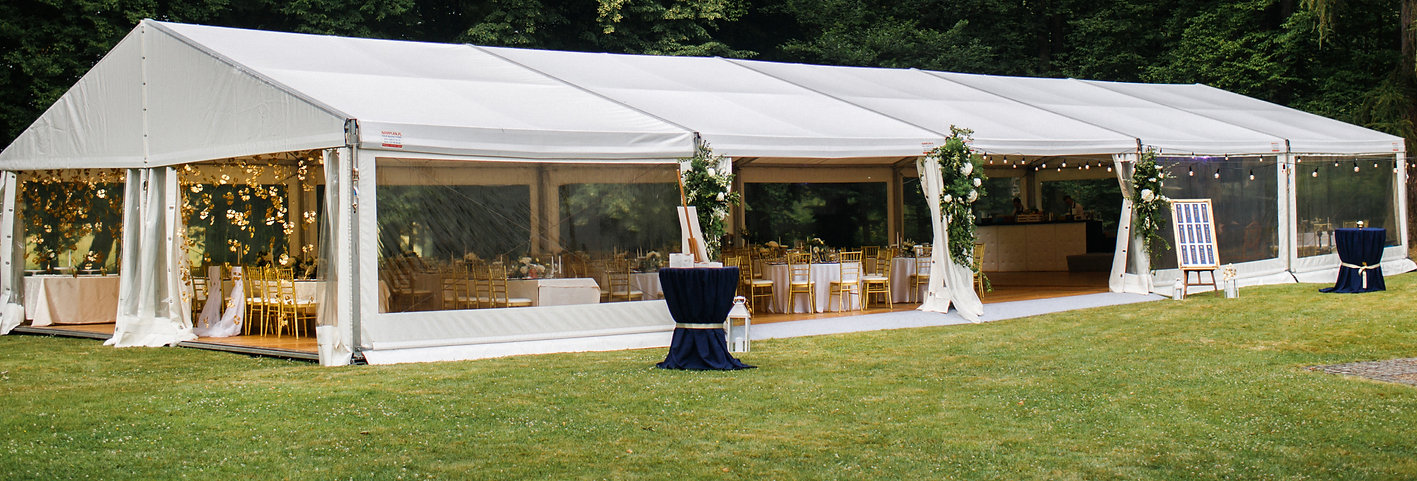 Long white tent for wedding party in the