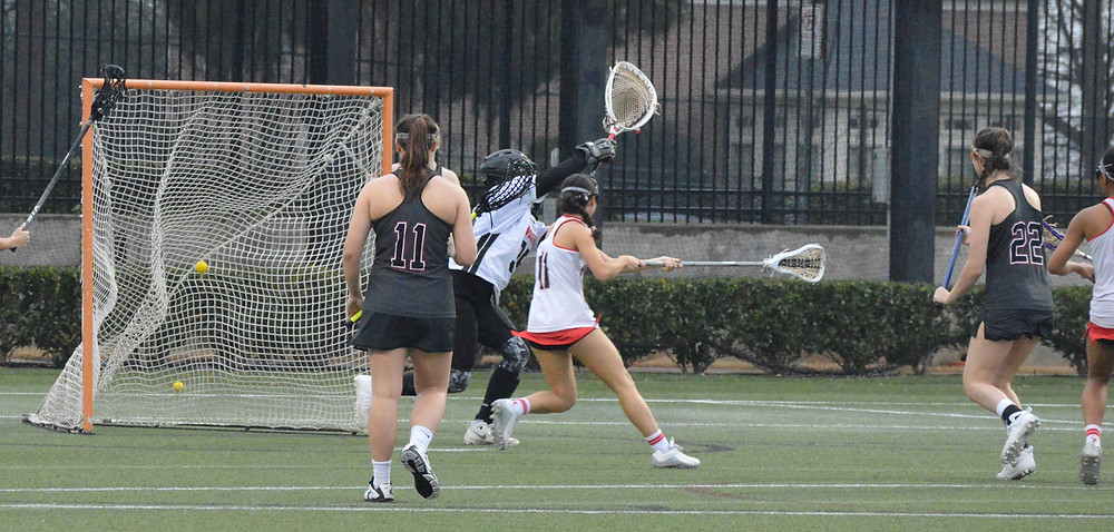 Lambert's #22 Peyton Smith watches as one of her 4 goals makes good