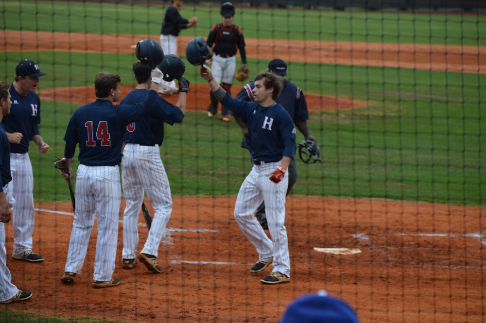 Heritage's #8 Sr. Joseph Hill scores off solo home run