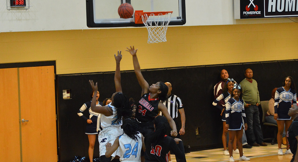 Lovejoy's #22 Brittany Smith lays it up over Jonesboro defender