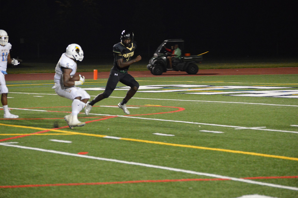 #5 Antonio Grier heads to endzone after int