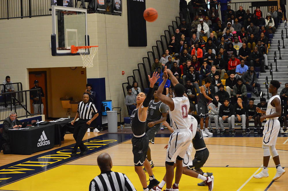 Pebblebrook's #0 Dwight Murray launches from deep
