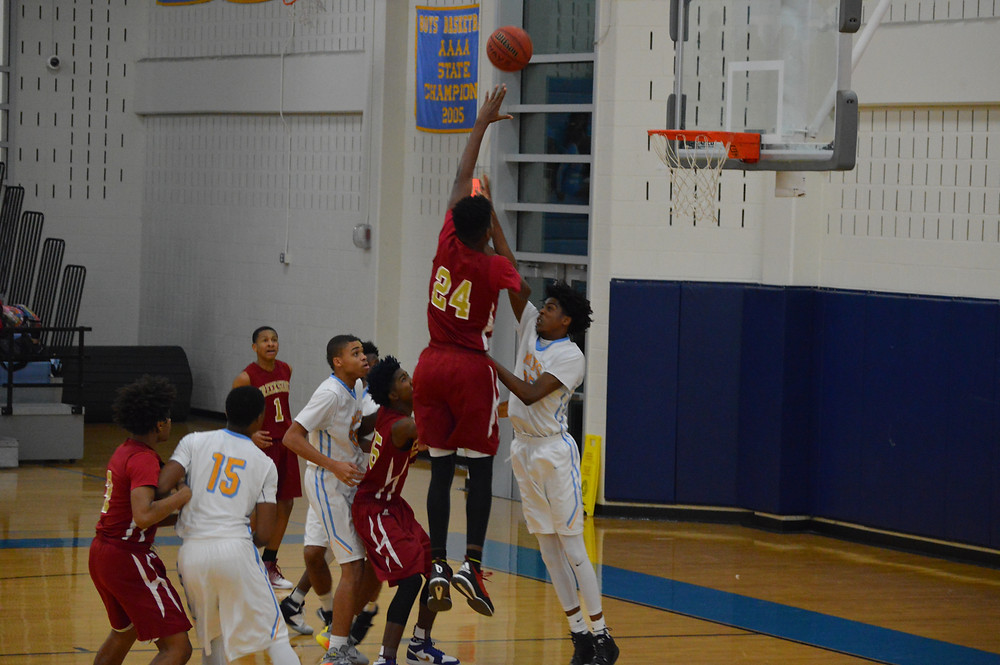 Creekside's #24 Jackson connects on 2 of his 22 points