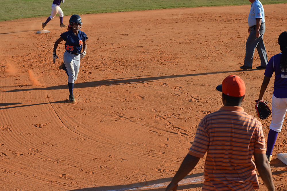 #25 heads into 3rd base after connecting for a triple