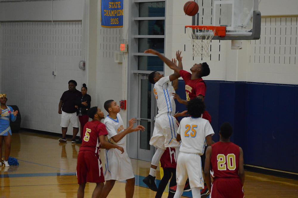 Creekside's #24 Jackson defending the basket