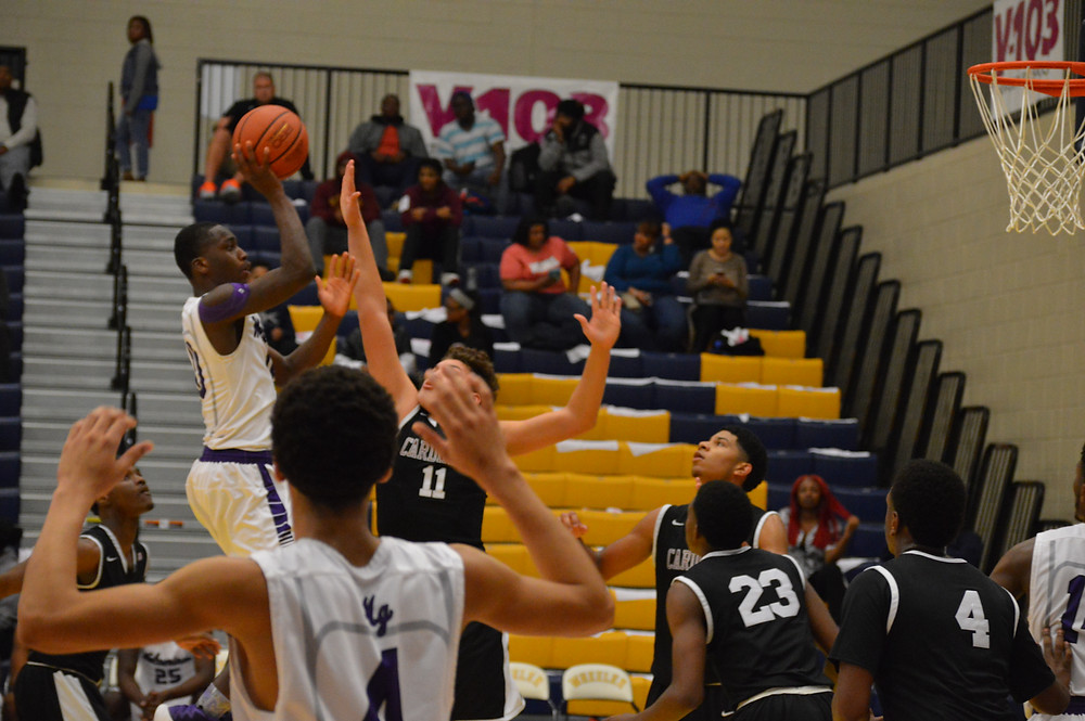 Miller Grove's #10 Naquante Hardy Scores 2 of his 18 points