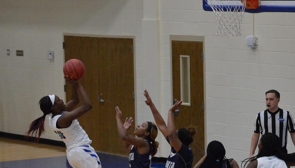 McEachern's #10 Q Morrison scores her 1,000 career pts with this shot