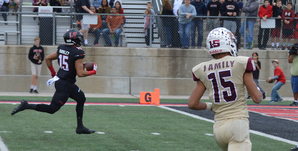 Lake Travis #15 Maleek Barkley finds end zone untouched