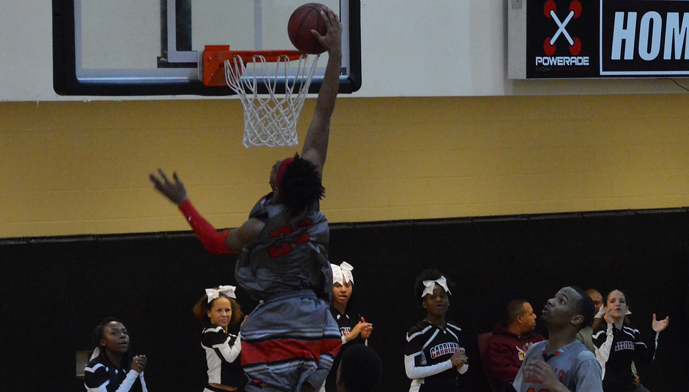 Jonesboro's #23 M.J. Walker slams home 2 of his 25 pts