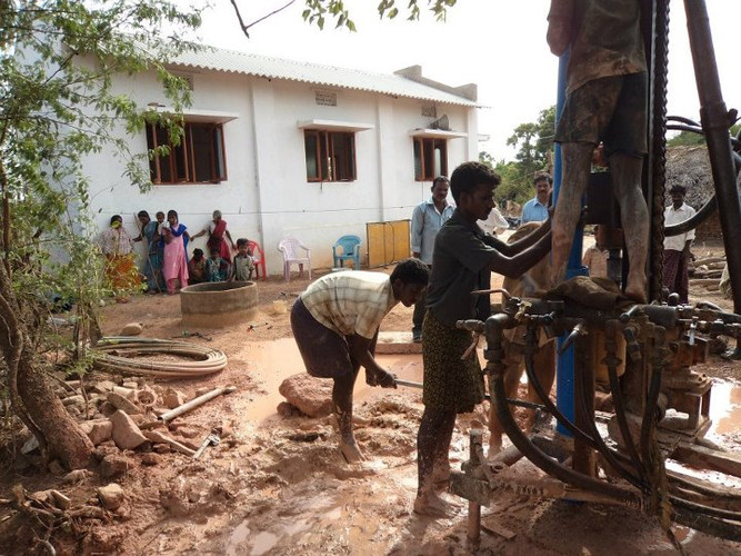 The well and machinery are being used to dig the 50 feet into the earth to reach clean water.