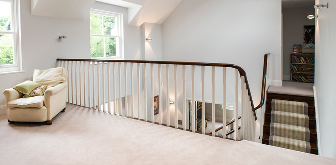 Continuous Handrail with White Spindles