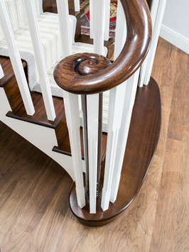 Dark Staircase with Continuous Handrail