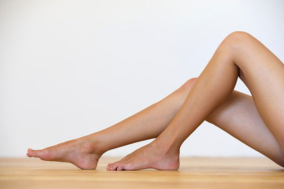 woman-bare-feet-floor-legs-care-skin-tre